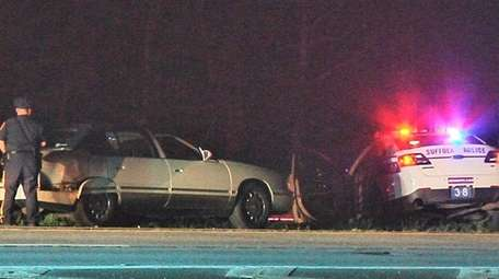 Police investigate a crash involving a Suffolk County
