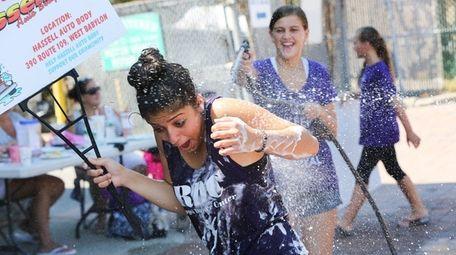 Giulia Mastronicola, 13, of North Babylon, is sprayed