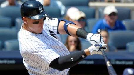 New York Yankees' Aaron Judge hits a home