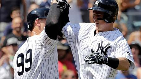 Yankees' Tyler Austin celebrates with Aaron Judge after