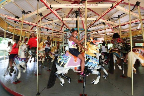 Jasonah Lovell, 10, of Roosevelt, rides the Hempstead
