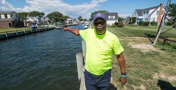 Amityville resident Chris Carman shows the need for