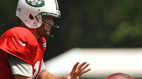 Ryan Fitzpatrick #14, New York Jets quarterback, takes