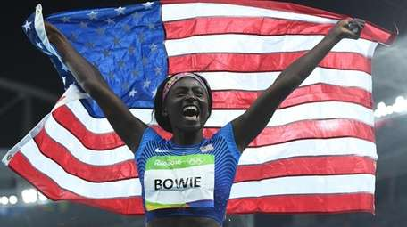 USA's Tori Bowie celebrates after she won the