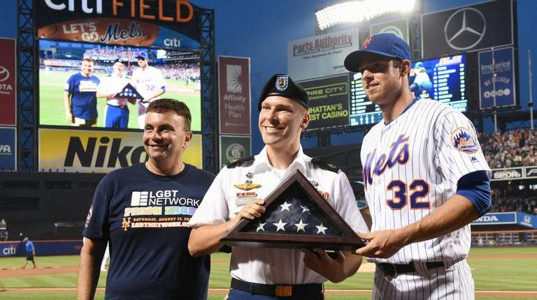Army Staff Sgt. Joshua Gravett, center, is honored