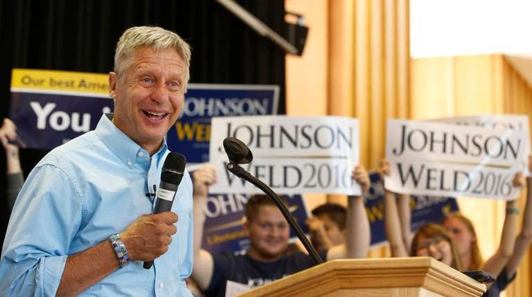 Libertarian presidential candidate Gary Johnson talks to a