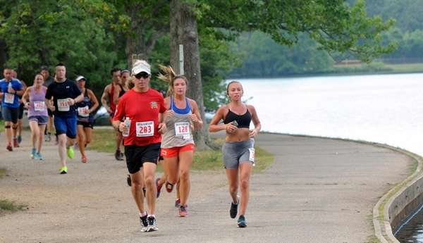 Runners pass through Belmont Lake State Park in
