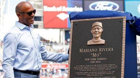 Former New York Yankees closer Mariano Rivera, left,