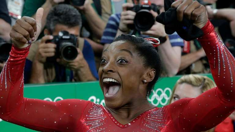 United States' Simone Biles celebrates after her winning