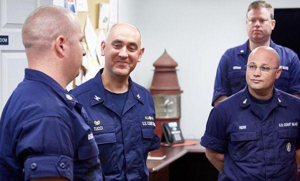 Capt. Andrew E. Tucci, center, who took