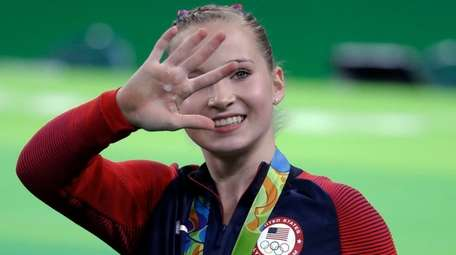 United States' Madison Kocian waves to the crowd