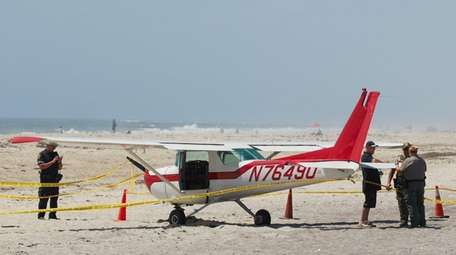 A small plane sits on the beach after