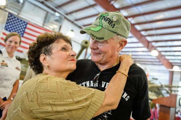 Vietnam Veteran John Schrank, of Dix Hills, embraces