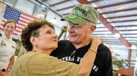 Vietnam Veteran John Schrank, of Dix Hills, embraces