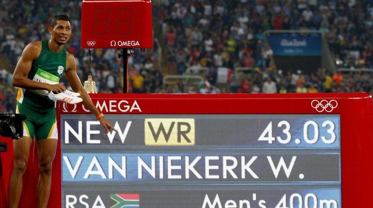 Wayde van Niekerk of South Africa celebrates placing