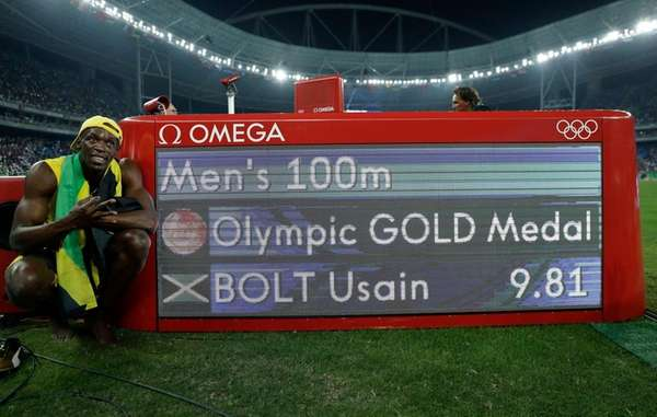 Jamaica's Usain Bolt poses beside the timing panel