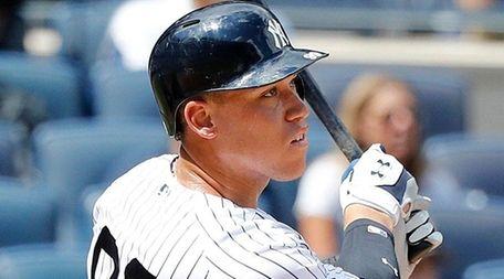 New York Yankees rightfielder Aaron Judge follows through