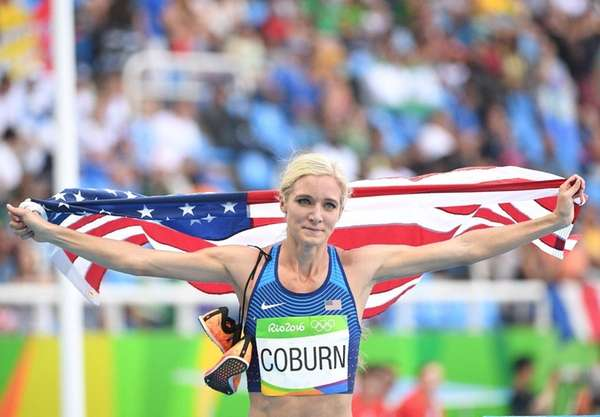 Emma Coburn celebrates her third-place finish in the