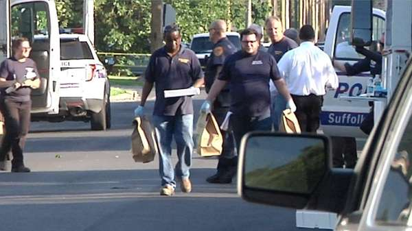 Police collect evidence after a Suffolk County officer