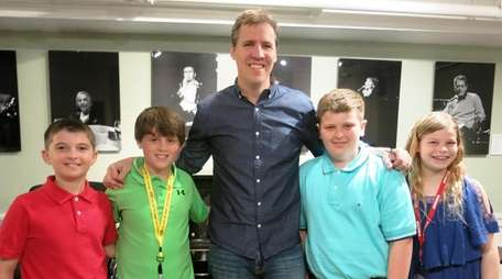 Author Jeff Kinney with Kidsday reporters, from left,