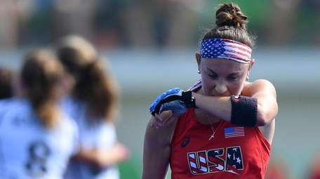 The USA's Michelle Kasold leaves the pitch as