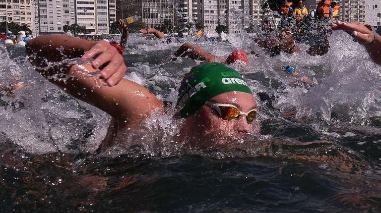 Swimmers compete during the Women's 10km marathon swimming