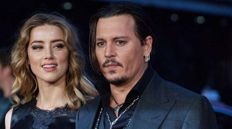 Amber Heard with estranged husband Johnny Depp in