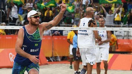 Brazil's Alison Cerutti celebrates after winning the men's