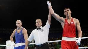 Russia's Evgeny Tishchenko reacts as he win the