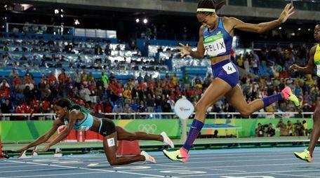 Bahamas' Shaunae Miller falls over the finish line