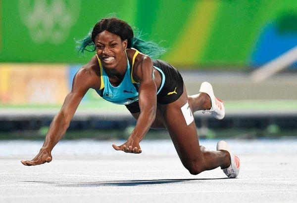 Shaunae Miller of the Bahamas crosses the finish