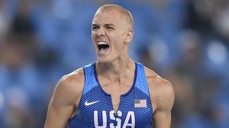 USA's Sam Kendricks reacts after a jump during