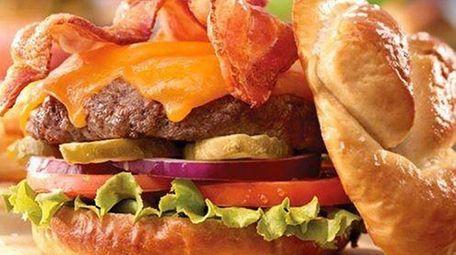 The bacon cheeseburger with a twisted pretzel bun