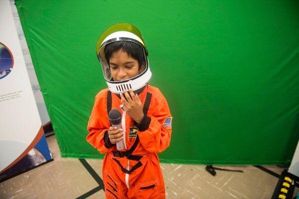 Araf Kabir, 8, tries on a space suit