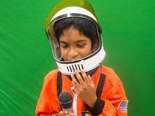 Araf Kabir, 8, tries on a space suit