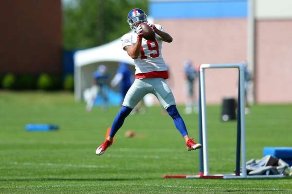 Giants wide receiver Myles White catches a pass