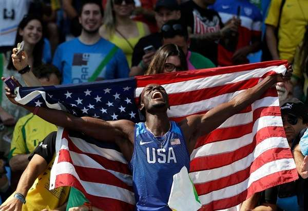 United States' Will Claye celebrates with the U.S.