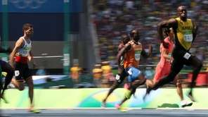 Jamaica's Usain Bolt, right, competes in a men's
