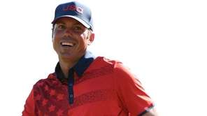 USA's Matt Kuchar reacts after putting for par
