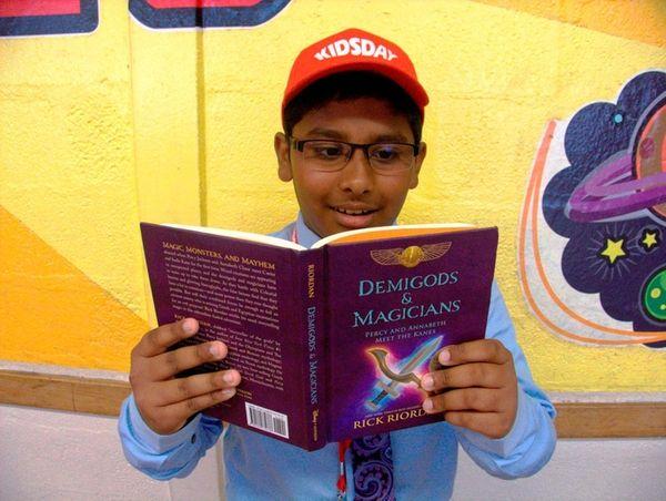 Kidsday reporter Caleb John reads Rick Riordan's book