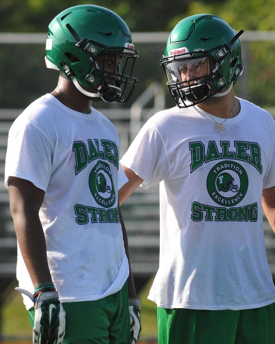 Farmingdale varsity football players participate in morning practice
