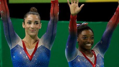 United States' Simone Biles, gold medal winner, and