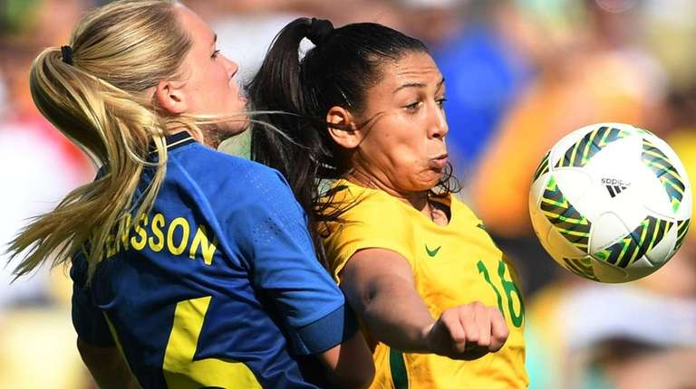 Brazil's player Beatriz (R) vies for the ball