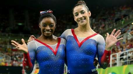 Simone Biles, left, and Aly Raisman of the