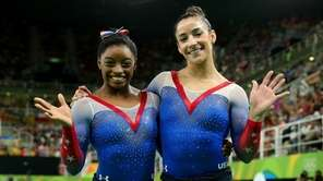 Simone Biles, left, and Aly Raisman of the