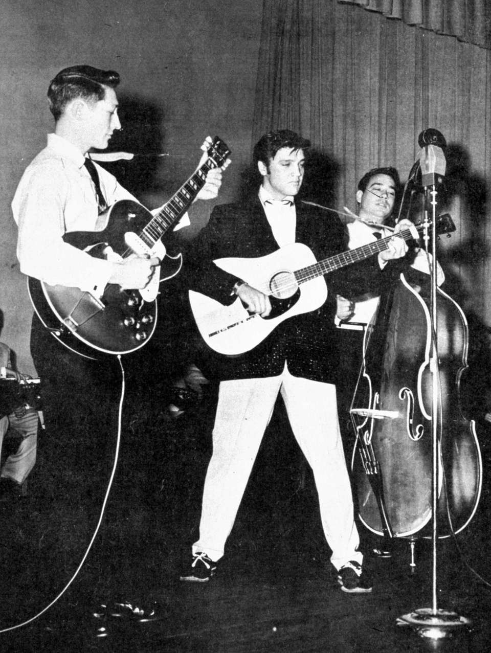Elvis Presley performs on tour in the summer