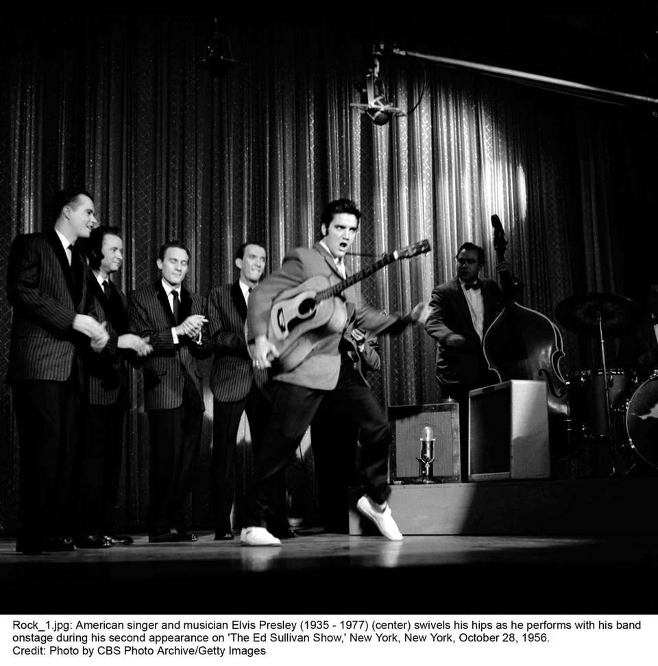 Elvis does his signature move -- swiveling his