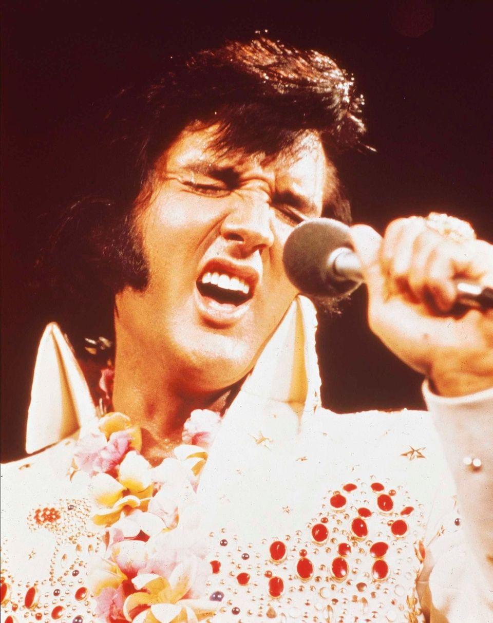 Elvis Presley performing live onstage at the