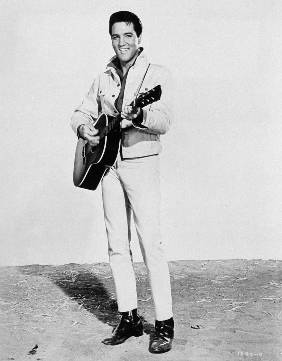 Elvis Presley as a guitar-playing hillbilly in the