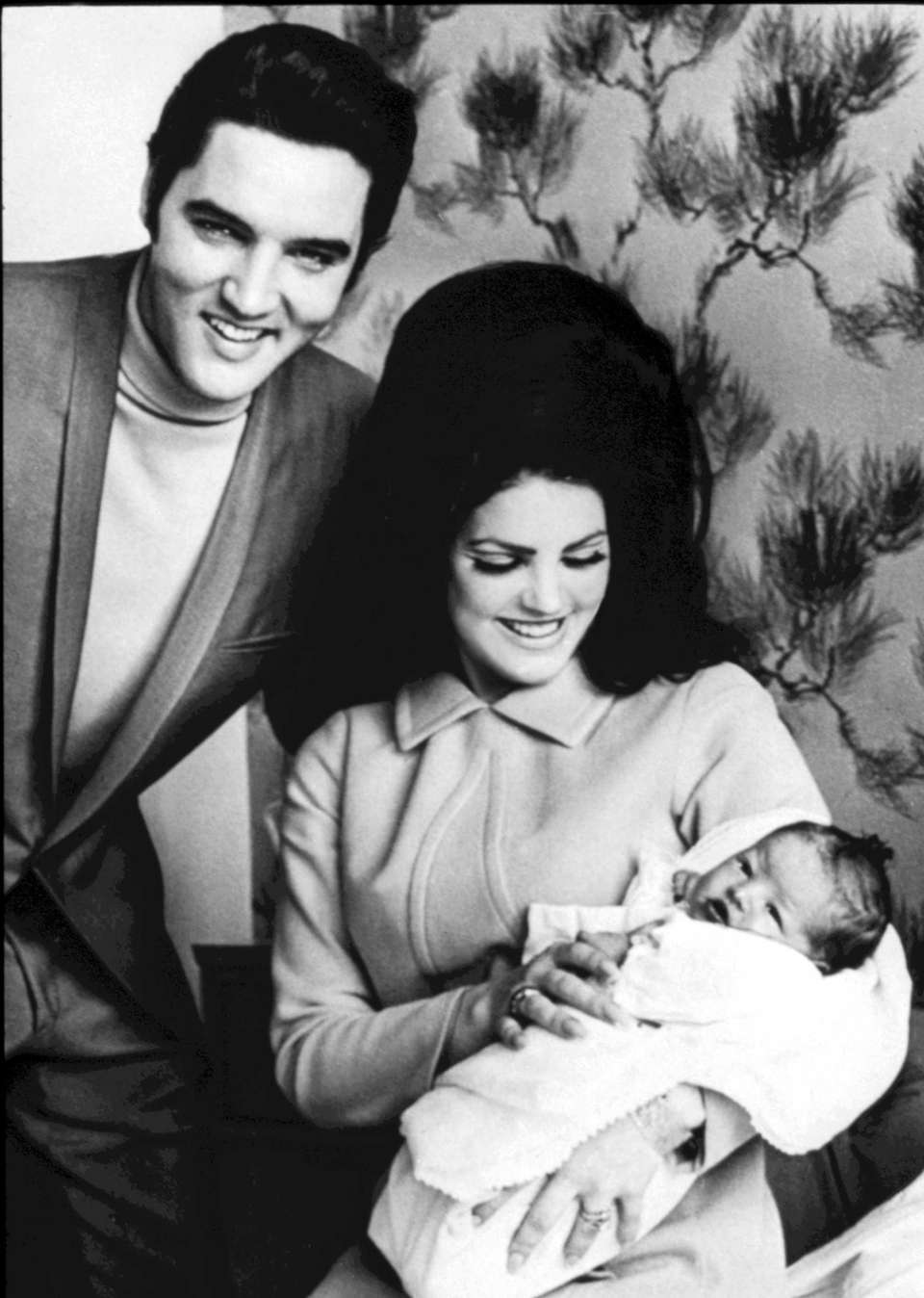 Elvis and Priscilla Presley with baby Lisa Marie